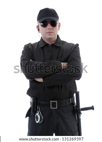 5bcd720c Policeman or security guard wearing black uniform and glasses standing  confidently with folded arms, shot