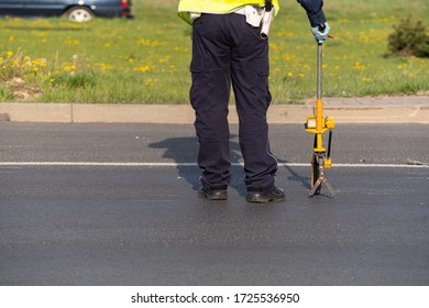 A policeman takes measurements after a rode accident.