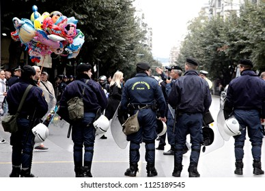 Policemen check the crowd during the parade marking Greece's Independence Day in Thessaloniki, Greece on Oct. 27, 2014