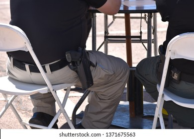 Policemen sitting at table with gun in holster Tempe Arizona 4/13/19