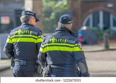 Policemen Walking On The Streets Of Amsterdam The Netherlands 2018