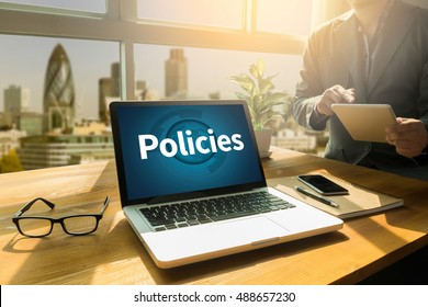 Policies                     Privacy Policy Information Principle Strategy Rules Thoughtful male person looking to the digital tablet screen, laptop screen,Silhouette and filter sun