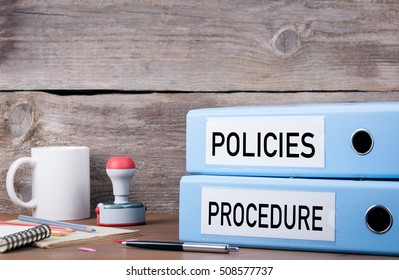 Policies and Procedure. Two binders on desk in the office. Business background