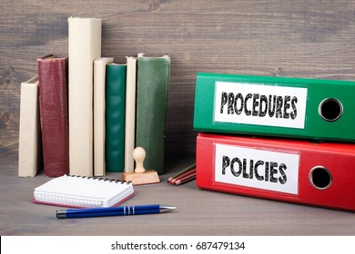 Policies and Procedures. Binders on desk in the office. Business background