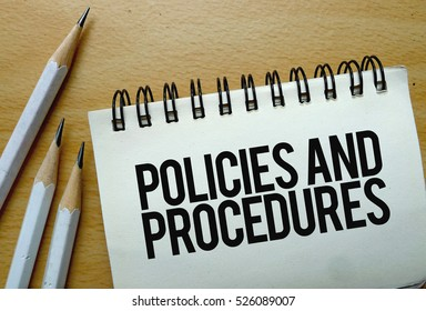 Policies and Procedures text written on a notebook with pencils