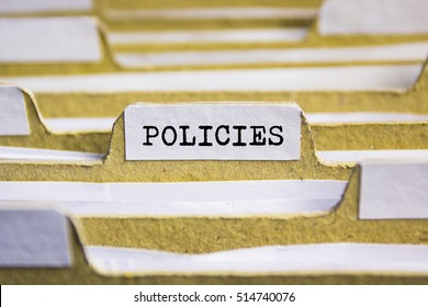 POLICIES word on card index paper