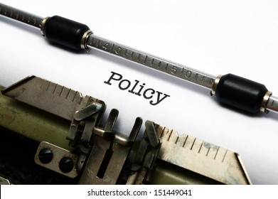 Policy text on typewriter