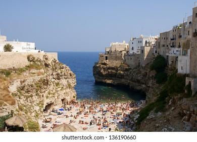 POLIGNANO A MARE, ITALY - AUGUST 19: Polignano a Mare beach on August 19, 2009 in Polignano a Mare, Italy. This famous beach, is located in a little bay on Adriatic Sea, province of Bari, Apulia.