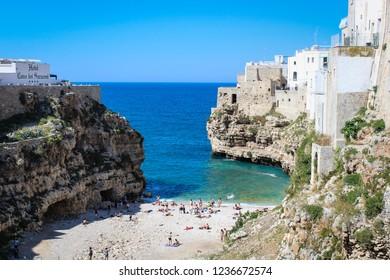 POLIGNANO A MARE, ITALY - MAY 18, 2017 - Scenic view of beach and bay in beautiful village of Polignano, Puglia.