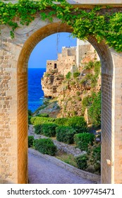 Polignano a Mare, Puglia, Italy: Ponte di Polignano bridge with Bastione di Santo Stefano and Lama Monachile beach in background, Apulia, Italy, Cala Paura gulf, province of Bari