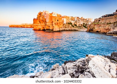 Polignano a Mare, Puglia, Italy. Sunset at Cala Paura gulf, province of Bari, Apulia, southern Italia on the Adriatic Sea
