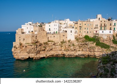 Polignano a Mare, Puglia/Italy - June 11 2019: Panoramic city skyline with white houses of Polignano a Mare, town on the rocks, Puglia region, Italy, Europe. Traveling concept background with blue sea