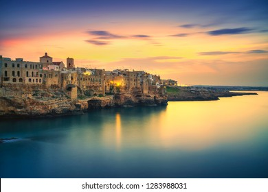 Polignano a Mare village on the rocks at sunset, Bari, Apulia, southern Italy. Europe.