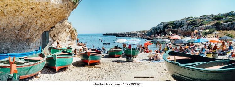 Polignano, Puglia Italy - 20 August 2019: Cala incina, free beach in Polignano a Mare