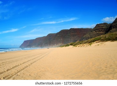 Polihale State Park on the Island of Kauai is the perfect spot to get away from the crowds.  Tire tracks in the sand lead the perfect hideaway.