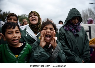 Polikastro, Greece - March 23, 2016. Children shout slogans as refugees and migrants block the main highway road near the northern Greek town of Polikastro at the Greek-Macedonian border.