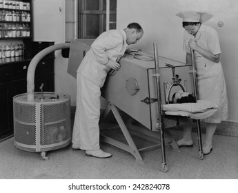 Polio patient in an iron lung at the Scots Mission Hospital in Tiberias, Palestine in March 1940. When polio weakened muscles used in breathing, an iron lung assisted respiration.