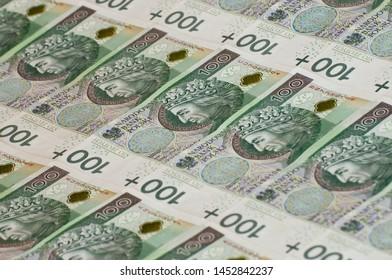 Polish business and finance. Money 100 gold, zl, zloty, PLN.