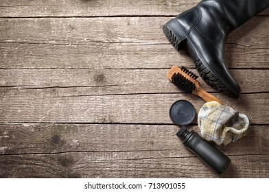 Polish cream, cloth and wooden brush for boots cleaning