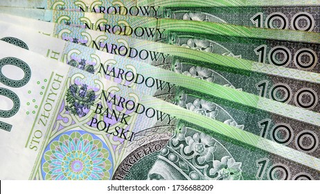 Polish currency banknotes, paper money background. Polish zloty (the masculine from the Polish word 'golden') currency closeup. PLN 100 / 100 zl. Financial growth, home budget, saving money, business.