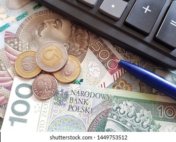 Polish currency, PLN, Stack of polish money. Business and financial concept. Polish Zloty banknotes (PLN) closeup, Polish money with pen and calculator