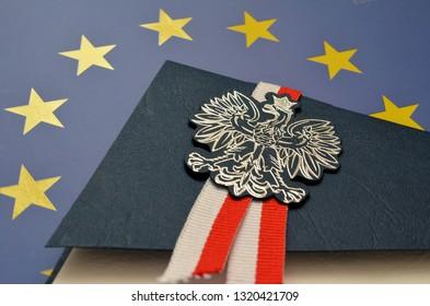 Polish emblem on the background of the EU flag
