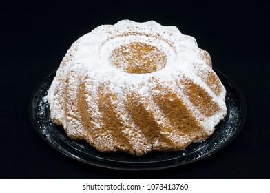 Polish or European Easter Babka Cake isolated on a black background.