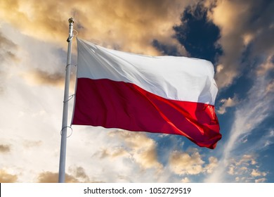 polish flag waving against sunset sky