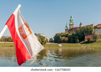 The Polish flag is waving on the Vistula with the center of Krakow in the background, Poland