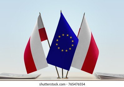 Polish flags and European Union flag between