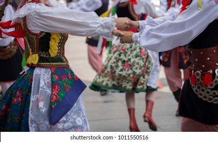 Polish folk dance goup with traditional costume
