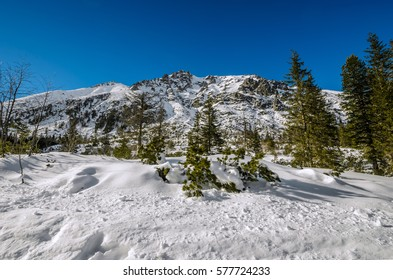 Polish High Tatra Mountains near Morskie Oko lake, covered by snow.