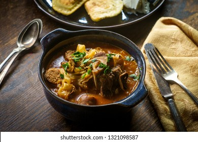 Polish hunters stew known as Bigos with pork loin sausage and lamb neck