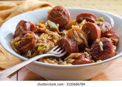 Polish kielbasa potatoes onions and peppers hash with cole slaw