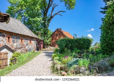 Polish Masuria lake district. Typical east prussia architecture. Wojnowo / Eckertsdorf. Poland.