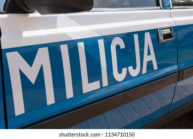 Polish Militia (old Police) sign on a door of old Militia car