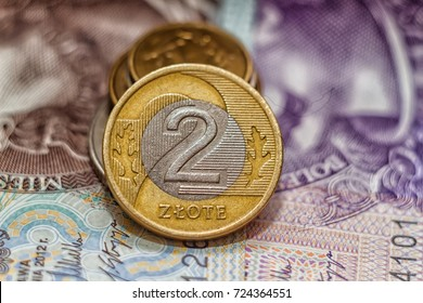 Polish money (2 zlote coin) over notes  background.  - Shutterstock ID 724364551