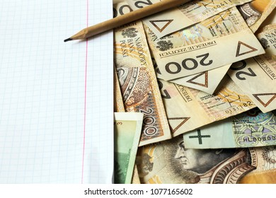polish money with sheet of paper and pencil