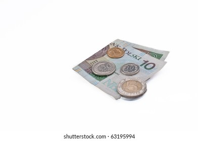 Polish money- ten zloty note, five zloty coin, one, ten and fifty grosz coins on white background