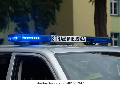 Polish municipal police with blue warning lights and sign. STRAŻ MIEJSKA means Municipal Police.