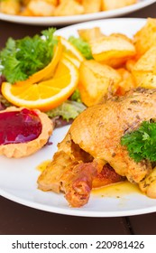 polish national dish - roasted duck with apples, oranges  and potato