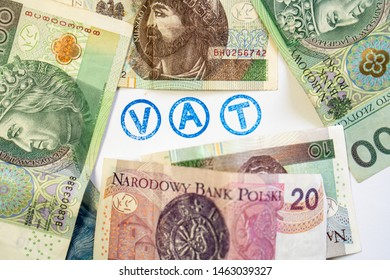 Polish new zloty (PLN) banknotes arranged around badge / stamp with the word VAT. Perfect as a tax background, a photo of a news about taxes.