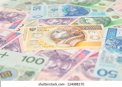 Polish paper money as background, with selective focus.