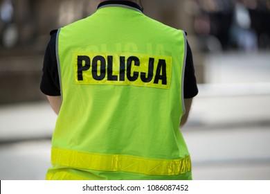 Polish policeman in reflective vest. Polish police