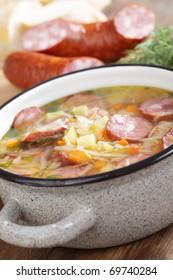 Polish sauerkraut soup Kapusniak in the pot