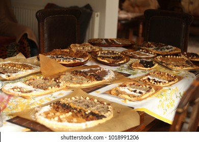 Polish tradition - easter mazurek cakes with nuts, carmel, coconut on a big wooden table