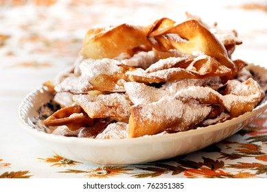 Polish traditional crispy dessert.Faworki or Chrust (depending of region) are sweet pastry made out of dough that has been shaped into thin twisted ribbons, deep-fried and sprinkled with sugar