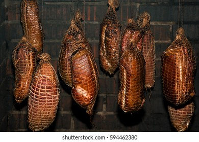 Polish traditional smoked cured meat in the smoking chamber.