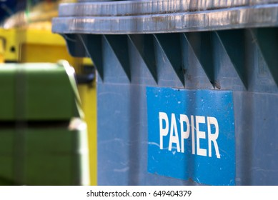 Polish word paper in a waste bin, waste segregation and environmental protection