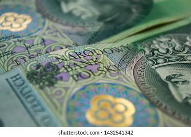 Polish zloty banknotes background. One hundred zloty banknotes. Macro photoshot. Narodowy Bank Polski